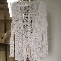 Pretty crocheted top and it ties...nice over anything  Size L/XL