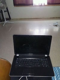 black laptop computer with AC adapter Calgary, T3K 6A3