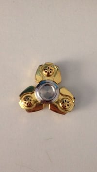 gold-colored and silver fidget hand spinner