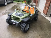 Green and black jeep wrangler rechargeable two seater.  Goods for ages up to 6 years old 373 mi