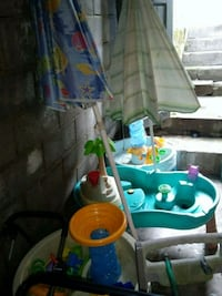 Water tables with umbrella and toys