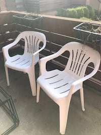 Two plastic Patio Chairs