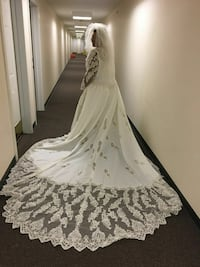 women's white floral long-sleeve wedding gown Manchester