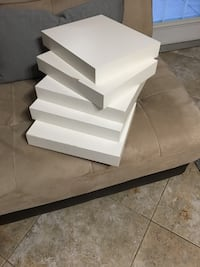 White shelves. Set of 5 from IKEA. Used with some scratches but clean and not noticeable when hung up