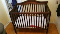 baby's brown wooden crib Toronto