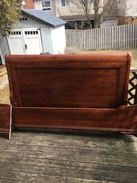 Solid wood Queen Sleighbed, headboard,footboard and side rails all solid wood. Need small repair to headboard where it connects to footboard. Pickering