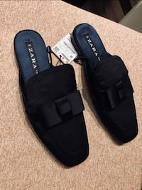 pair of black Toms slip on shoes Whampoa, 329973