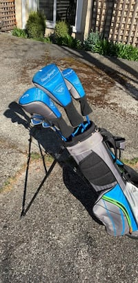 Black and blue golf bag & club set.   Vancouver, V6R