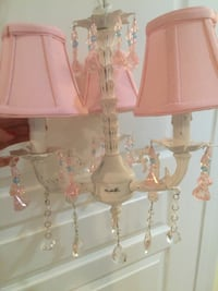 Crystal Chandelier with Pink and partial blue Prisms with Pink Shades.  Reston