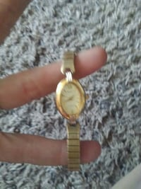 round gold analog watch with gold link bracelet Chowchilla, 93610