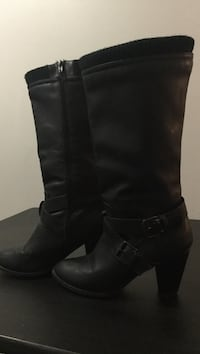 pair of black leather boots Calgary, T2A 3T6