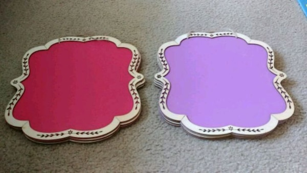 pink and purple wooden framed chalkboards