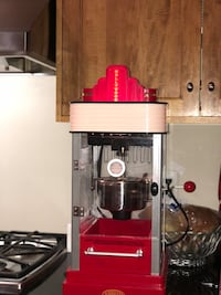 red and gray Nostalgia Electric popcorn maker