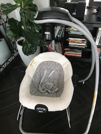 Baby's white and gray swing/seat