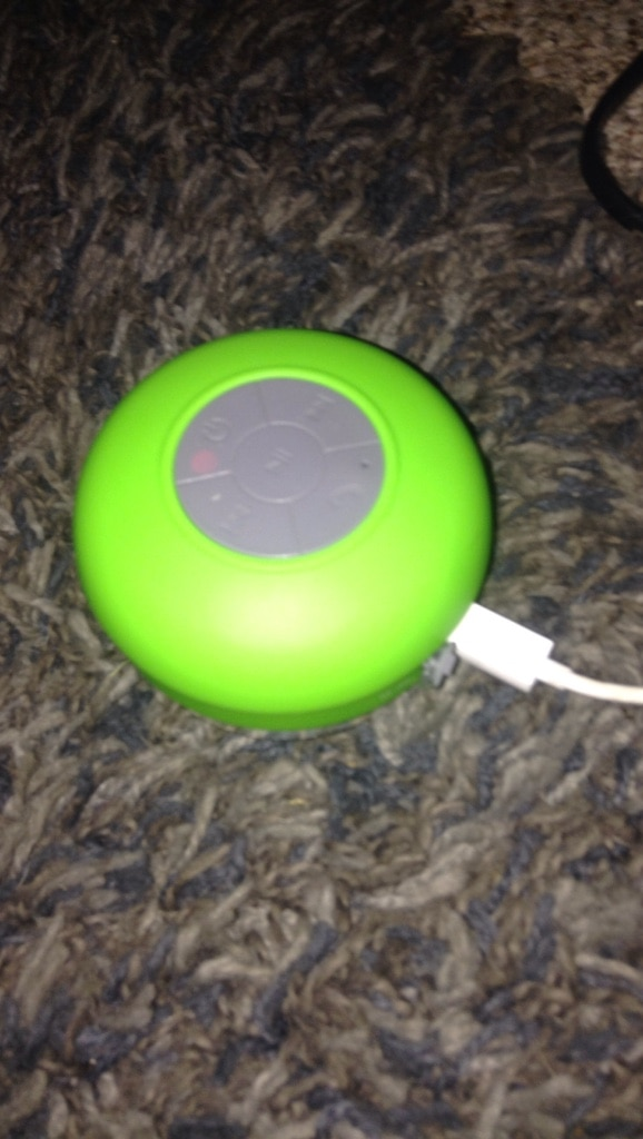 round green and gray portable music player