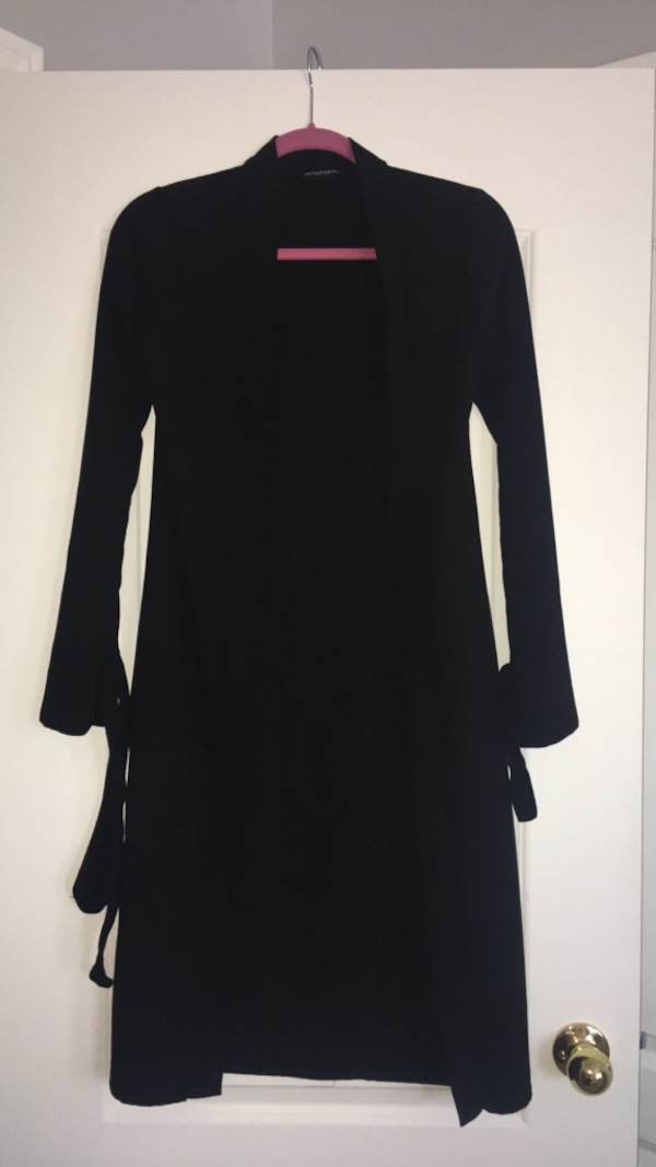 Black long-sleeved, light over coat