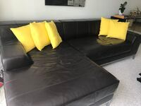 Black leather sectional sofa with throw pillows South San Francisco, 94080