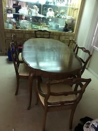 oval brown wooden table with four chairs dining set Hemet, 92544