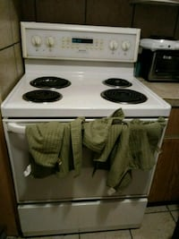 white and black electric coil range oven Montreal, H1G 4L1