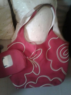 white and pink floral hobo ba