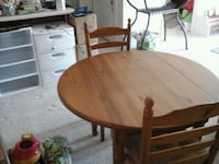round brown wooden table with two chairs dining s Whitesboro, 13492