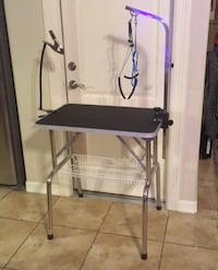 Dog grooming table and restraint