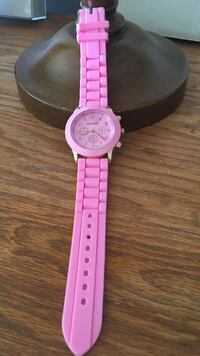 round pink chronograph watch with link bracelet