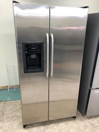 36 x 70 GE stainless steel side-by-side refrigerator in excellent working condition 100 days warranty Baltimore, 21222