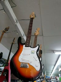 brown and white stratocaster guitar Edmonton, T5T 4C8