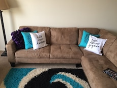 Brown microsuede padded chaise couch with throw pillows