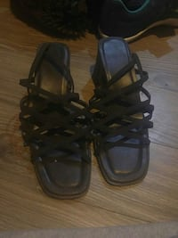 pair of black leather open-toe strappy sandals Calgary, T2K