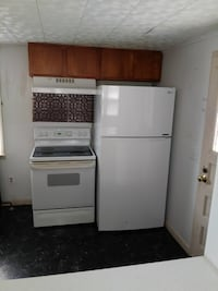 white top-mount refrigerator and white induction range oven