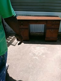 brown wooden single pedestal desk Baltimore
