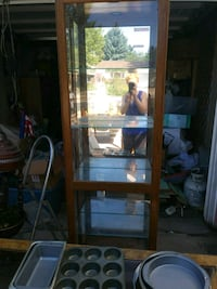 brown wooden framed glass display cabinet Colorado Springs, 80919