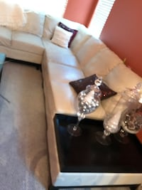 White leather sectional with end tables and matching coffee table