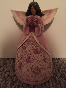 pink and white floral angel ceramic figurine