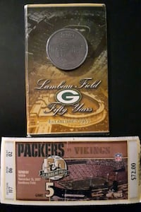 Green bay 50 yr coin and ticket stub