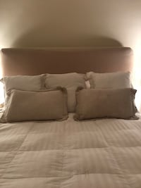 Tan linen upholstered and slip covered in same fabric headboard New Orleans, 70115