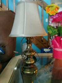 gold and white table lamp