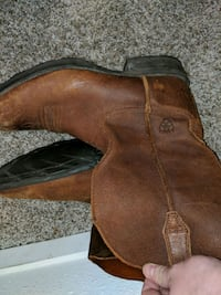 pair of brown leather cowboy boots Houston, 77058