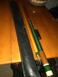 brown and green billiard cue stick set Cheney