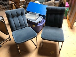 Two blue cloth chairs
