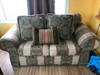 gray and green floral loveseat 469 km