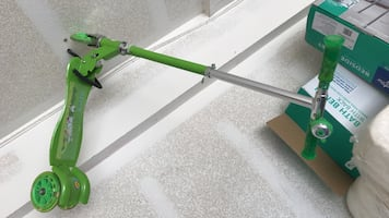Green and gray kick scooter