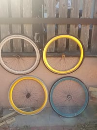 four white, yellow and blue bicycle wheels 2339 mi