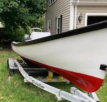 """18'7"""" boat with center console with a 40hp Suzuki oil injected two stroke"""
