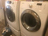 SAMSUNG washer and electric dryer on stands, moving need to sell Glendale, 85306