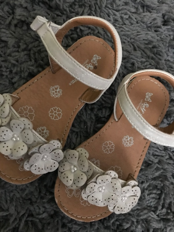 brown-and-white leather sandals