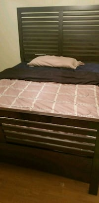 2 brown wooden bed frames sold separate  Chelsea, 35043