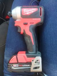 1/4 inch Milwaukee impact driver with high output battery and charger